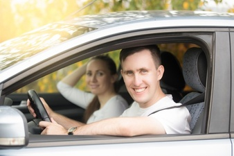 young-smiling-man-driving-and-woman-sitting-in-the-car_1163-2672.jpg